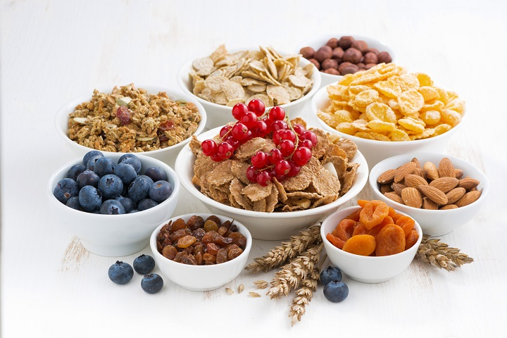assortment of different breakfast cereal, dried fruit and fresh